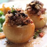 Thyme Scented Baked Onions with Bacon & Cheese