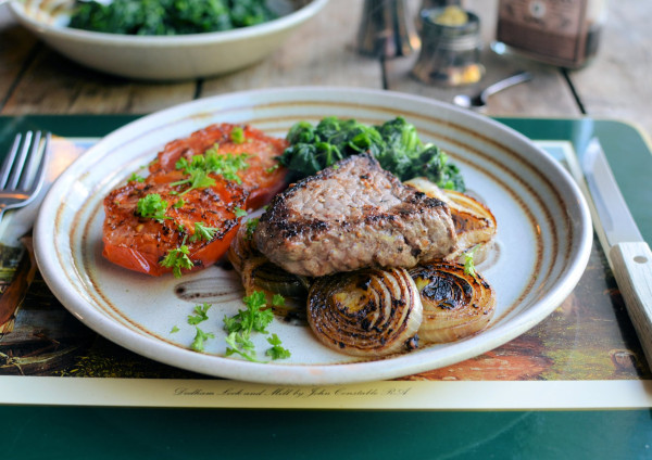 Pepper Steak with Pan-fried Onions, Tomatoes and Nutmeg Spinach