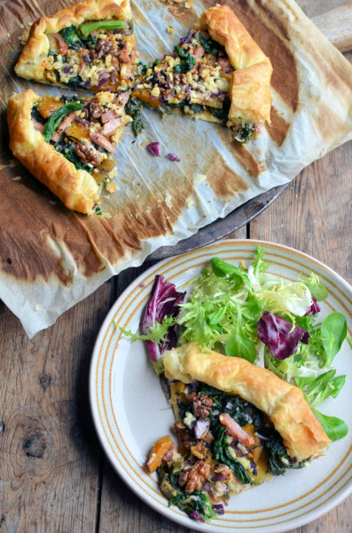 Pumpkin, Kale and Walnut Galette with Pancetta and Onion Jam cut and served