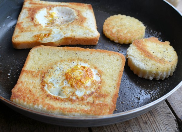 Frying the egg in a basket or egg in a hole WITH the holes!