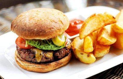 Homemade beef burger with Stilton rarebit, burger sauce and chunky ...