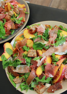 A salad of caramelised peach with rocket, Wensleydale cheese and Parma Ham with sourdough croutons by Peter Sidwell