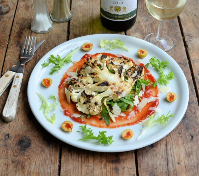 Cauliflower Steaks with Grana Padano Cheese, Olives and Rocket Leaves