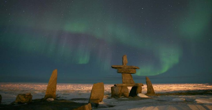 Northern Lights and an inuksuk in Churchill