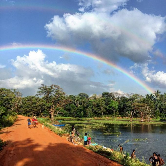 Double rainbow over Hiridunna Village and Lake