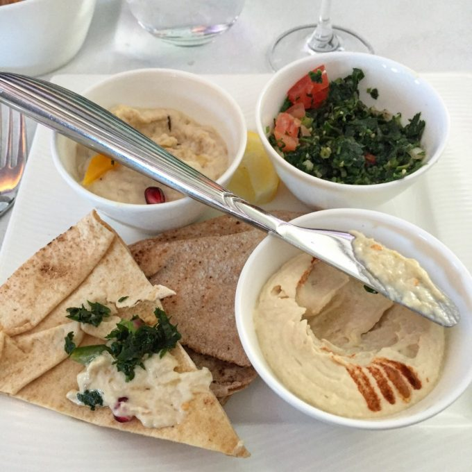 Classic Arabic mezze hummus, tabouleh, muhammara and lahim bil agine served with arabic bread