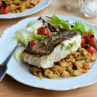 Pan-fried Skrei Cod with Scorched Cherry Tomatoes, Black Garlic and Harissa Crushed Cauliflower Mash